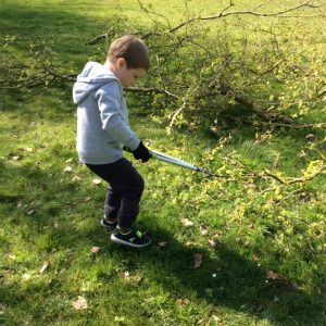 Helping to cut branches